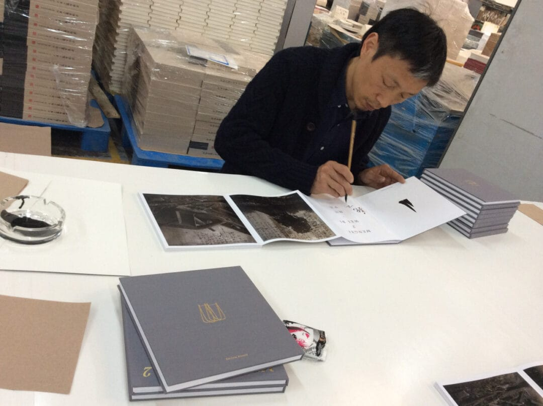The Chinese artist Wei Bi signs …