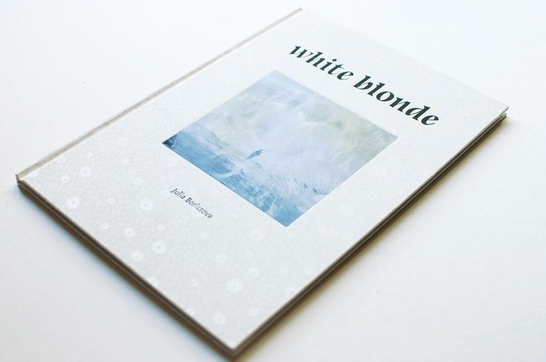 """A bit cool ice in this hot summer!  The book """"White Blonde"""" has been published in Paris by Edition Pierre Bessard. Limited edition of 250 copies, with a 15×20 cm signed C-Print.  Antarctica is a special place with particular stories and memories, the polar explorers called it """"white blonde"""". Through my series I aimed to convey a feeling of the hostile and unfamiliar environment of South Pole, creating images where the geographic reality give way to the space of dream. I froze the archival photos of Antarctic expeditions, as well as my own specially photographed for the project self-portraits, turning them into """"icebergs"""". I wanted to being a part of the landscape to express a sense of awareness of time, to show the fear of oblivion, termination of activity, entropy through a collision with a smooth, hard, cold ice surface. Using photographs, found pictures and collages I explore the themes of personal and collective history, imagination, memory, the built and natural environments. The character of my work makes me think of the nature of photography, which always fluctuates between materiality and visuality."""